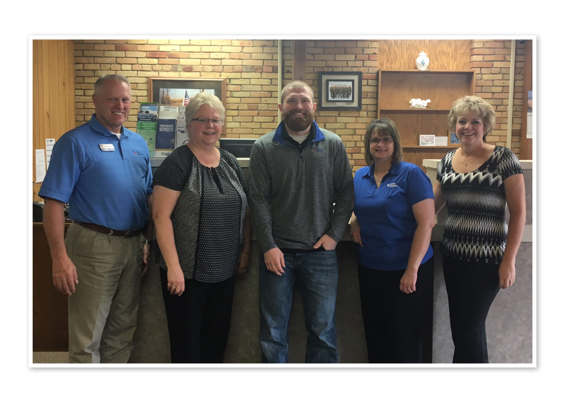 The team stands together in the Media bank. (Left to Right) Gerald Horner, Karen Schlecht, Todd Olson, Val Leier, Rhonda Schlecht