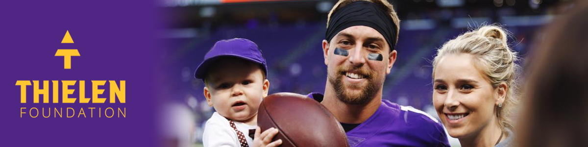 Adam Thielen with his wife and son.